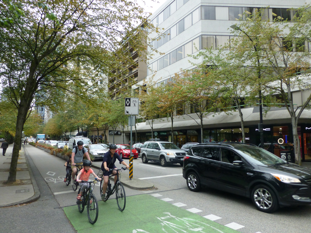 Together but separated: Vancouver's bike lanes are enjoyed by families even during rush hour © David Arminas/World Highways
